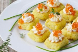 Potato muffins with cream cheese and red caviar