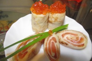 Original beer pancakes with red caviar and salmon